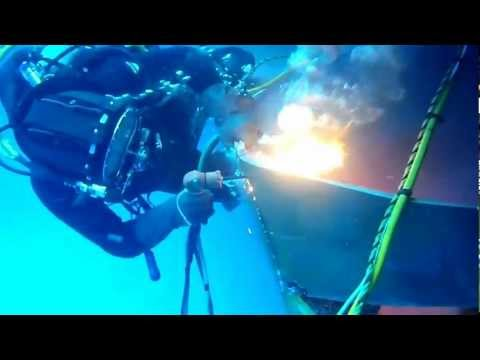 "Commercial Diver burning off damaged steel plate underwater using ""Broco"" oxy-thermic torch"