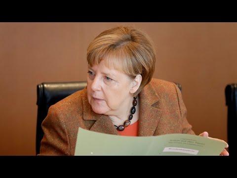 Merkel tells Germans to sing Christmas carols while Berlin burns