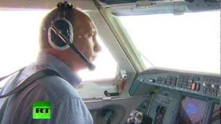 Putin fights wildfires with water bomber