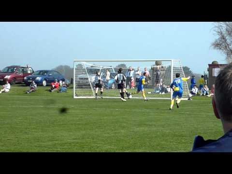 St John's Andy Glover scores against Colby Woods C...