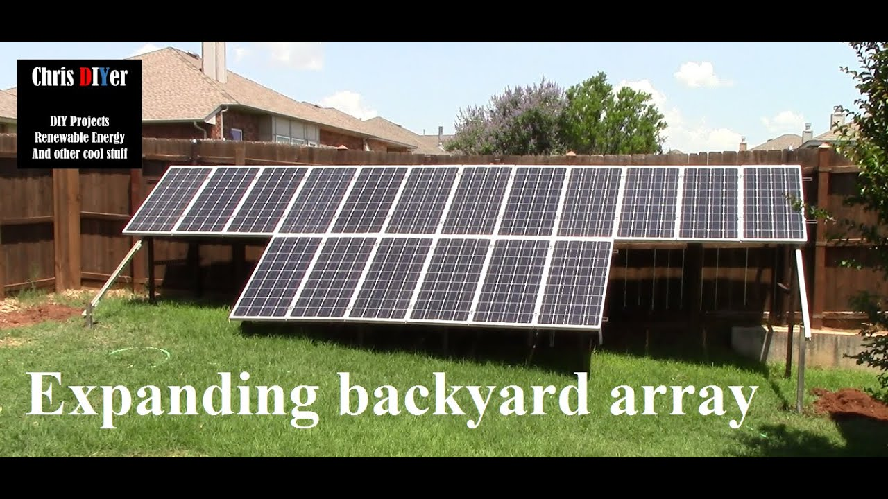 Expanding suburbia backyard fenceline solar panel array ...