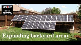 Expanding suburbia backyard fenceline solar panel array, hung pergola shade tarp, and repaired gate