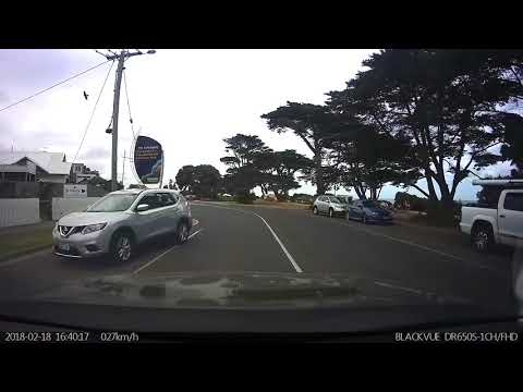 Tourist driving on the wrong side of the road on Victoria's surf coast