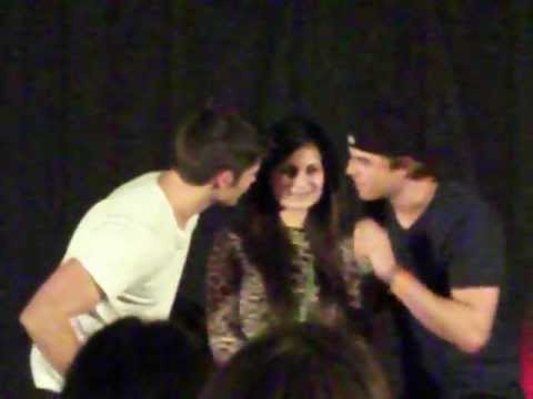 nathaniel buzolic and steven r mcqueen kissing a fan