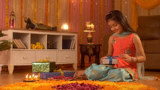 A cute little Indian girl opening her Diwali gift with a happy and excited mood - Festival Celebration