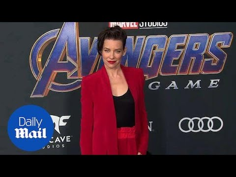 Evangeline Lilly dresses in red suit for Avengers premiere