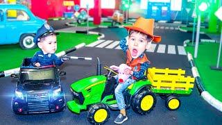 Ride on Power Wheels Cars at Amusement Park.