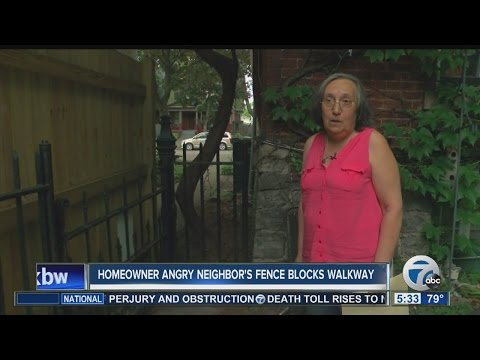 Homeowner angry neighbor's fence blocks walkway - YouTube