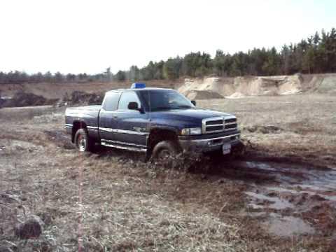 my buddys 2001 dodge ram 1500 going through mud - Dodge Ram 1500 Lifted Mudding