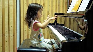 Download lagu Listening to Piano by Emilie Barton, 2 years old