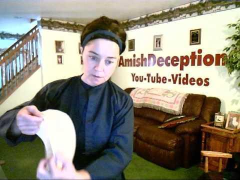 Swartzentruber Amish lady putting up her hair