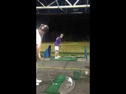 You'll want to watch this incredible two-man golf trick shot over and over again