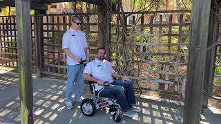 Porto Mobility Ranger Lightweight Folding Electric Wheelchair Operated by Caregiver & Attendant