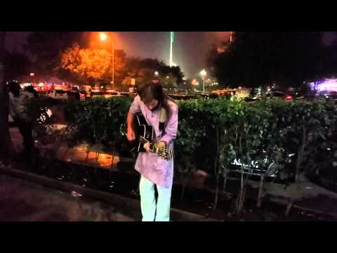 Hippy playing guitar at connaught place Delhi