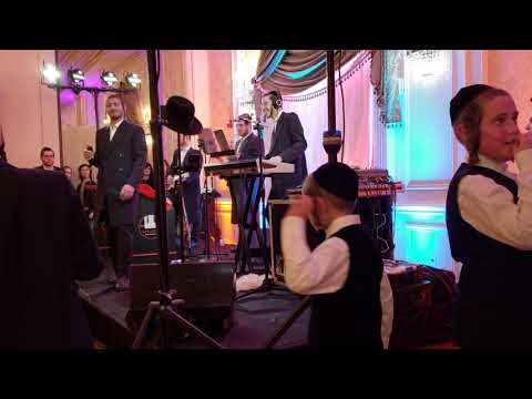 Muchy gluck Levy falkowitz levy lasin and more at a wedding