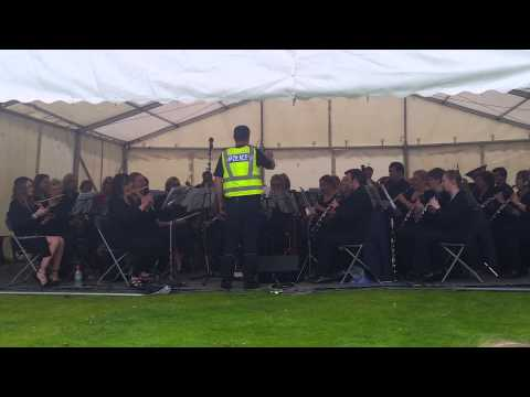 Local policeman conducts Dunbartonshire Concert Band at Kirky Canal Festival