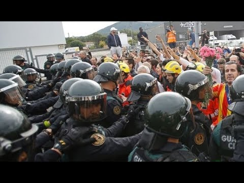 SPAIN NATIONAL POLICE USE VIOLENCE TO SHUT DOWN CATALAN SECESSION ELECTIONS.