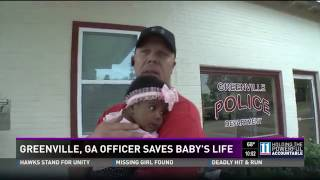 Police Officer now Godfather of Baby he saved