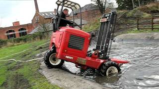 Moffett truck-mounted forklift goes swimming - dive, dive dive!