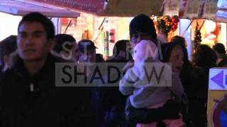 EXCLUSIVE : Pink, baby Willow and husband Carey Hart christmas market on Champs Elysees Paris