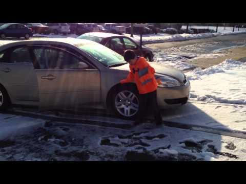 Car slides down driveway