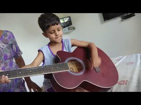 5 Years Old Meera Kairay Playing Guitar