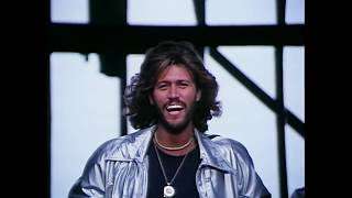 Bee Gees - Stayin' Alive (1977)(Join Bee Gees on Facebook http://facebook.com/beegees & Twitter http://twitter.com/beegeesofficial STAYIN' ALIVE Well, you can tell by the way I use my walk ..., 2009-10-27T01:32:08.000Z)