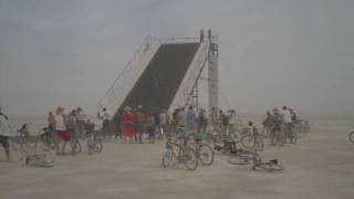guy riding a bike down a 45 degree slope at Burning Man 2009