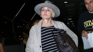 Makeup Free Sharon Stone Holds Her Head High At LAX