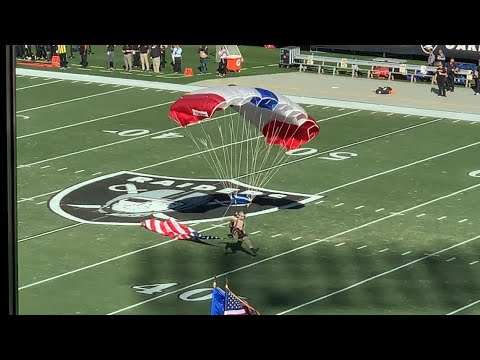 US. Army Parachutists Fly In To Oakland Coliseum For Bengals Vs Raiders Game