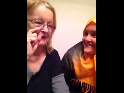a Muslim woman helps her mom to take the Shahada