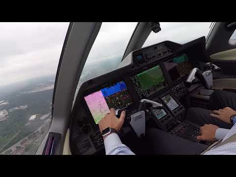 Phenom 300 - Cockpit View - ILS and Landing at KPDK on a busy day