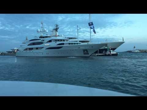 Superyacht Galaxy by Benetti with Paris Hilton docking in Marina Ibiza next to Megayacht Palladium