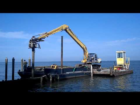 Piling Driving with Excavator on Chesapeake Bay