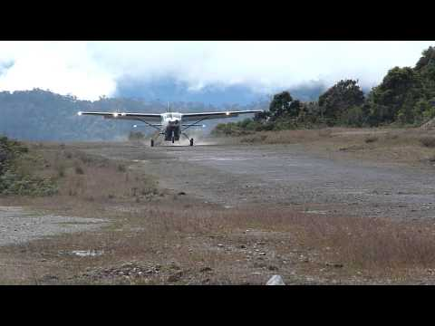 External View Susi Air Cessna Grand Caravan C208B Landing in Bilogai, Papua, Indonesia