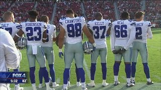 Cowboys stand during anthem; other players protest