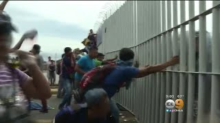 Mexico Border Gate Torn Down As Migrant Caravan Heads North Towards US