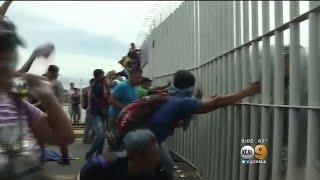 Mexico Border Gate Torn Down As Migrant Caravan Heads North Towards US thumbnail