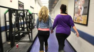 Tori being escorted to the stage as Justin Bieber