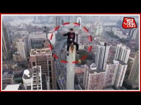 China's 'Spiderman' Climbs The Tallest Tower In Shanghai