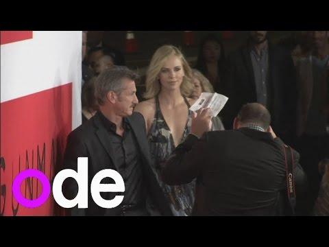 CharlizeTheron holds on to boyfriend Sean Penn at The Gunman premiere
