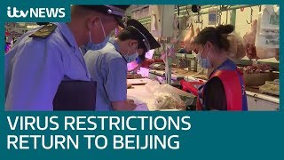 Coronavirus and its restrictions return to Beijing after Covid-19 outbreak at market | ITV News