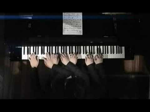 korean guy playing a piano with eight hands