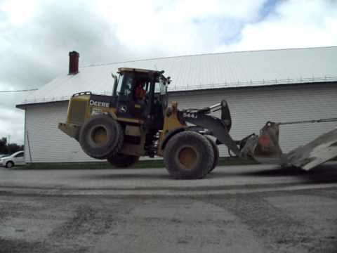Wheelie Tricks With A John Deere 544J Front End Excavator