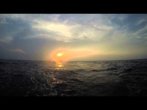 The setting sun in the South China Sea 4K