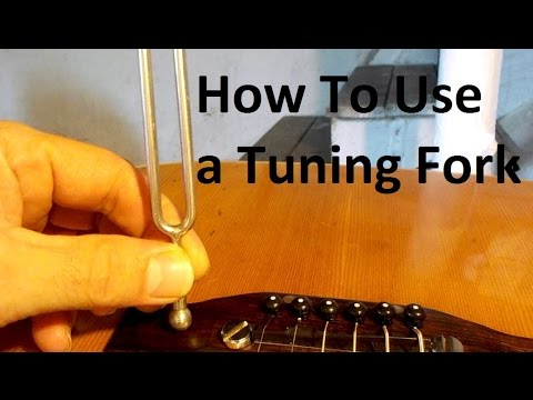 tuning a guitar with a tuning fork how to use a tuning fork on a acoustic and country music. Black Bedroom Furniture Sets. Home Design Ideas