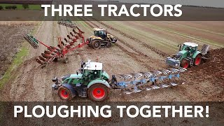 Three Tractors Ploughing Together