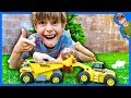Toy Dump Trucks and Loaders Collect Christmas Rocks!