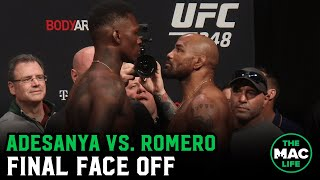 Israel Adesanya and Yoel Romero have intense final staredown as Adesanya smokes a Cuban cigar