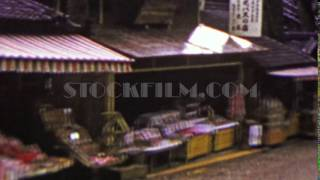 1951: Japanese street farmers market small merchants selling food. OSAKA, JAPAN